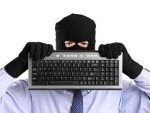 8711729 a hacker with robbery mask holding a keyboard isolated on white background 150x113 Securing Your Digital Image. Threats From Social Media Services